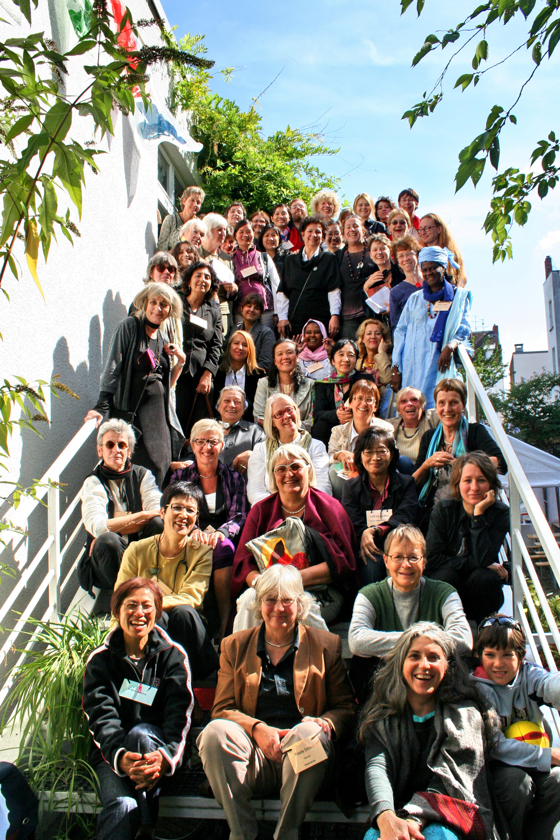 Participants of the 2009 conference assemble on the stairs as a group